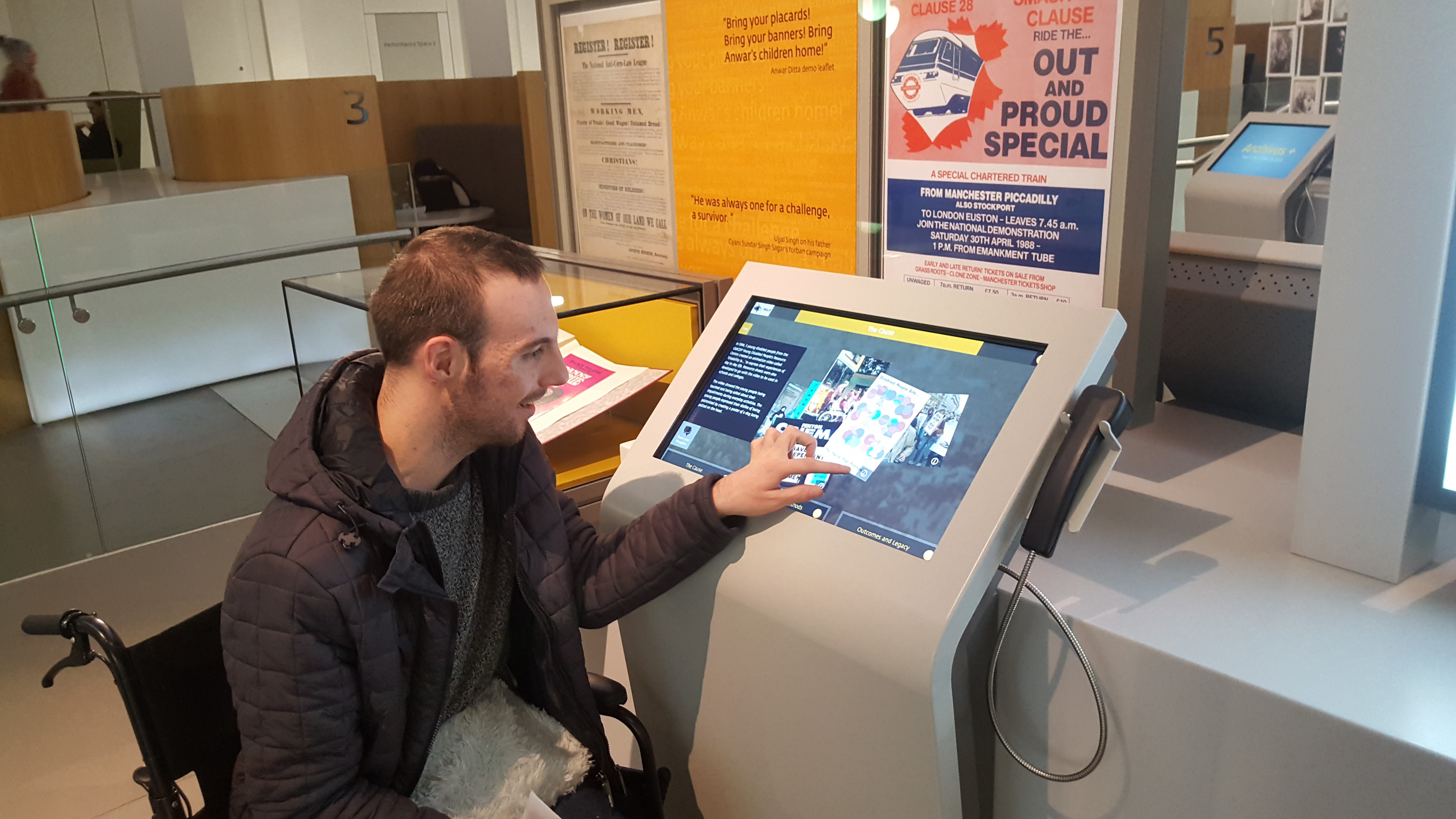 A disabled person using Archives+ at Manchester Central Library